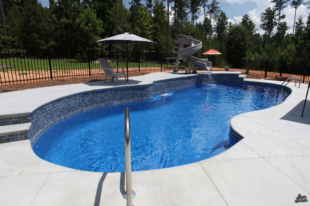 Leisure times pools featuring san juan fiberglass pools for Pictures of a pool